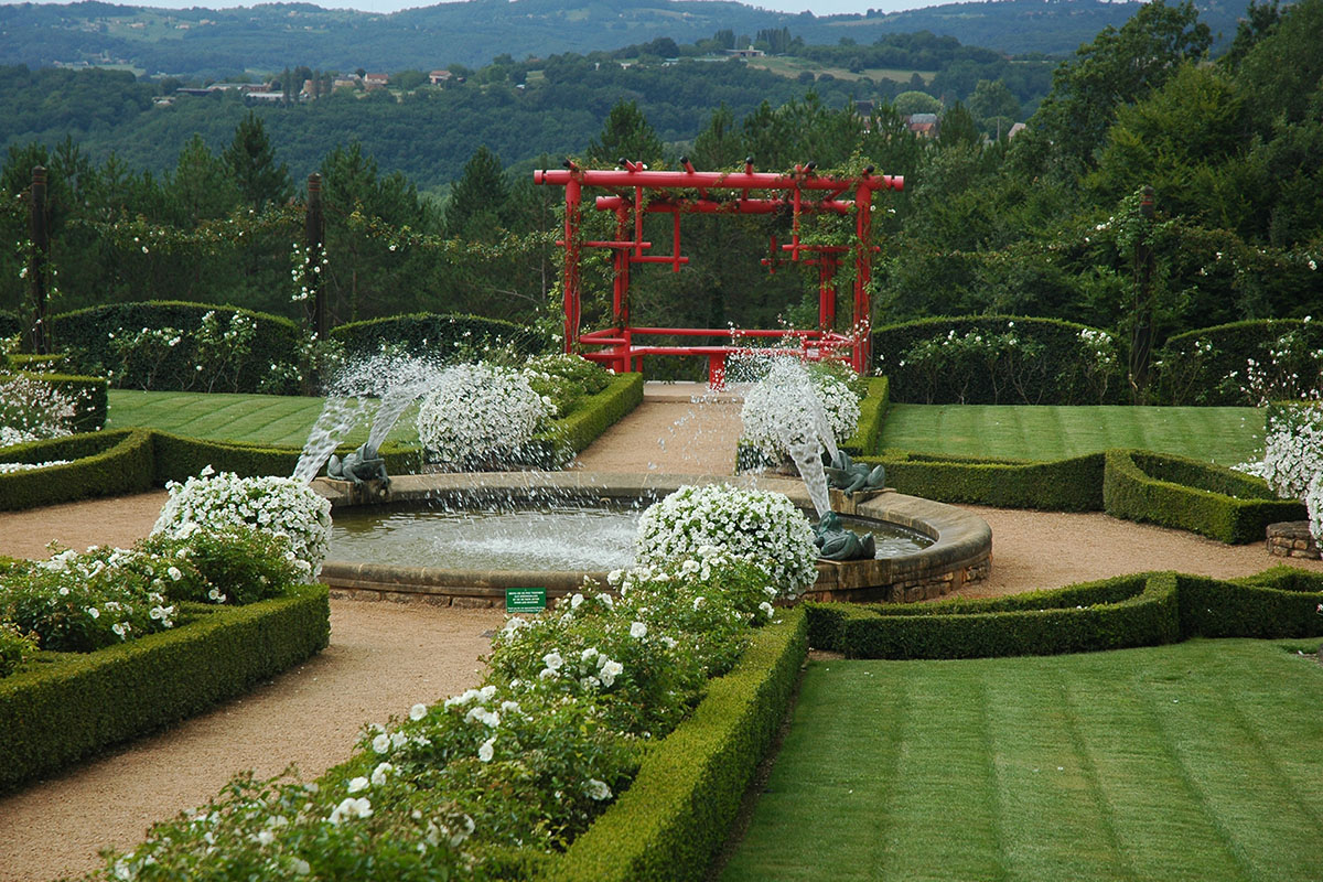 The white garden in the gardens of Eyrignac's manor in Dordogne Valley in France
