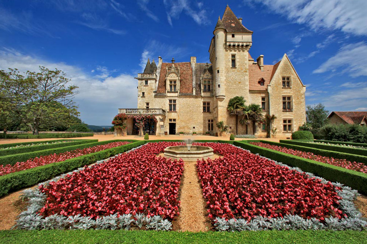 The flowers of the French gardens of the Château des Milandes in Dordogne Valley in France