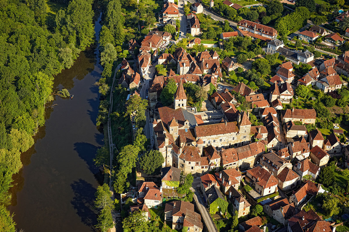 The medieval village and the Dordogne River of Carennac from above in Dordogne Valley in France