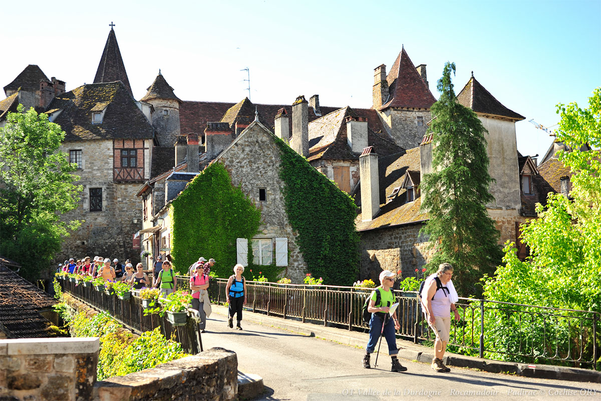 The bridge and houses of the medieval village of Carennac in Dordogne Valley in France