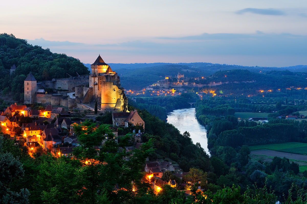 The Dordogne Valley in France with the Château de Castelnaud by night
