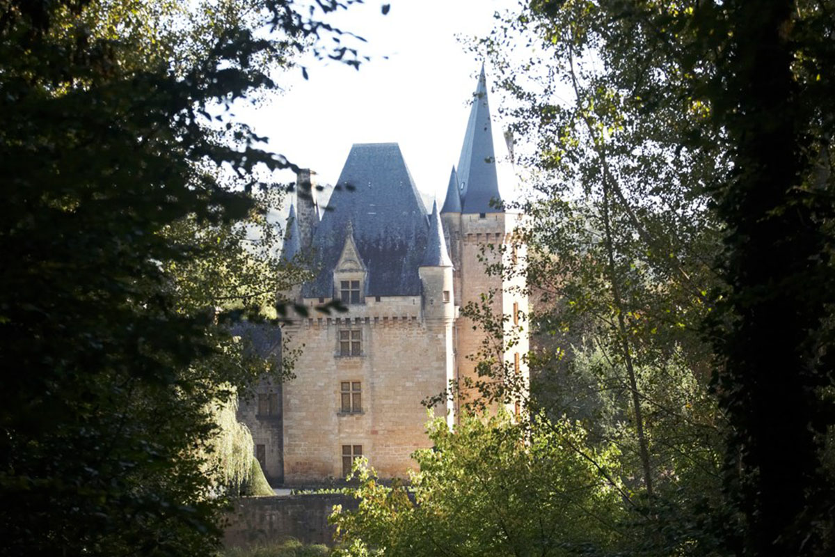 View of the castle of Saint-LEon-sur-Vézère in Dordogne Valley in France