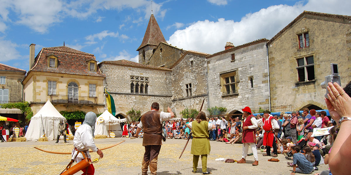 A summer medieval festival in the village of Monpazier in Dordogne Valley in France