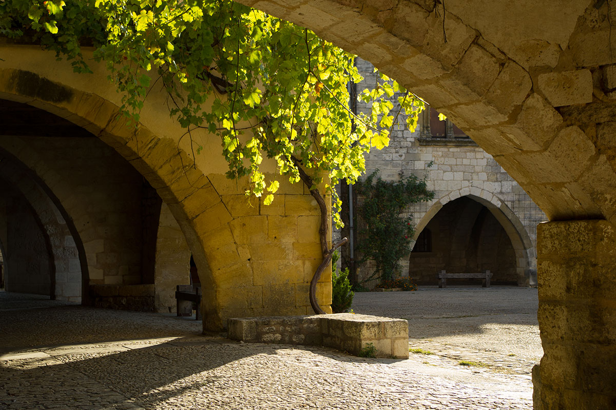 Archway in the medieval village of Monpazier in Dordogne Valley in France