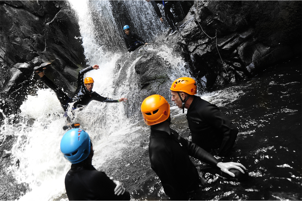 A group of friends doing a canyoning trip in the Dordogne Valley in the South West of France