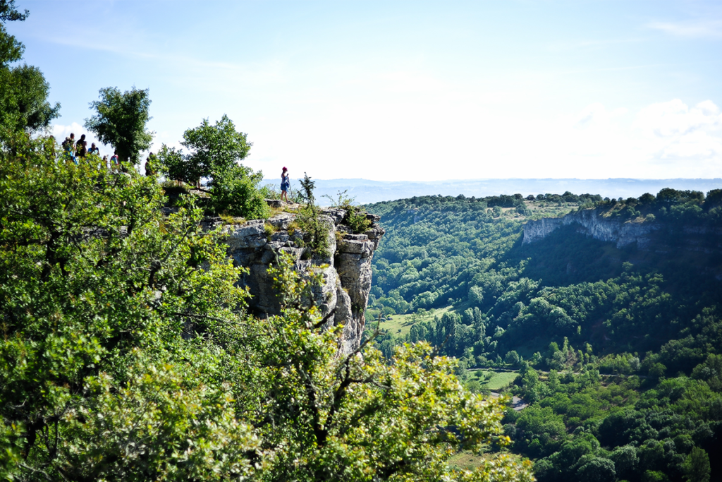 A woman hiking in Autoire in the Dordogne Valley in the South West of France