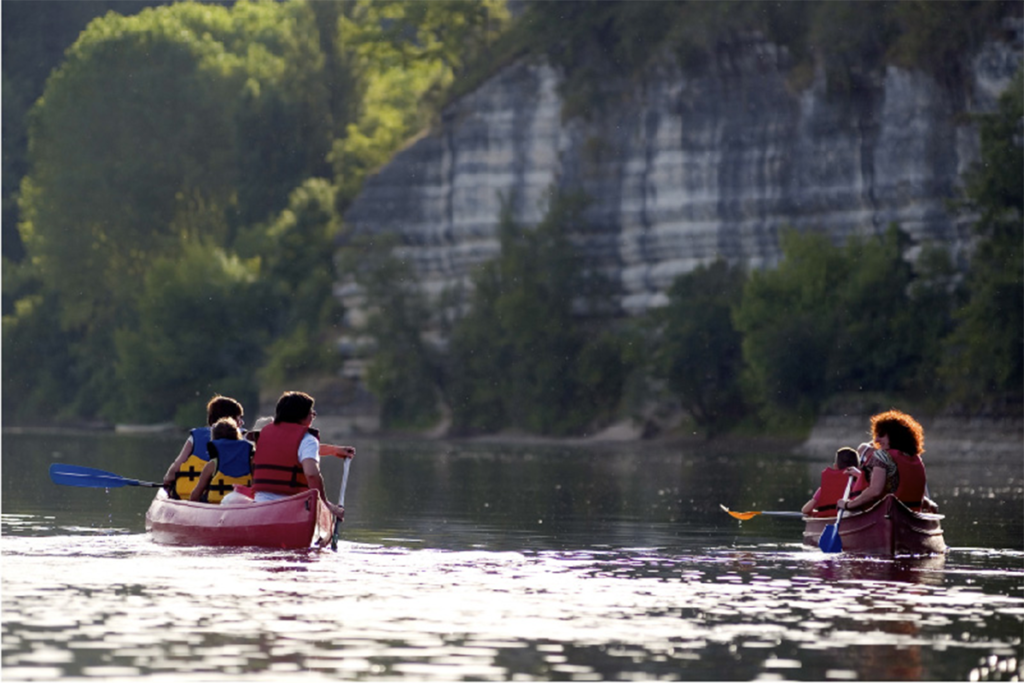 A family on a canoe ride on the Dordogne River in the South West of France